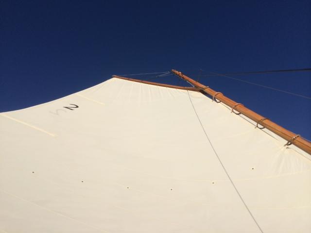 Looking up at the mast and gaff mainsail